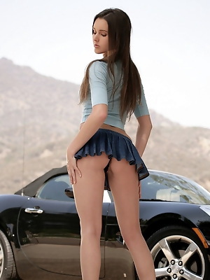 washes her car in a short...